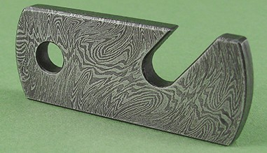 Damascus steel bottle opener